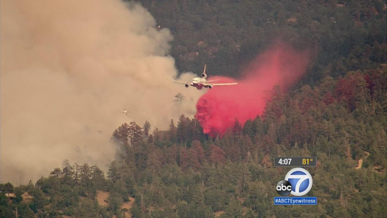 An air tanker makes a water drop over the Summit Fire in Big Bear on Monday, Aug. 24, 2015.