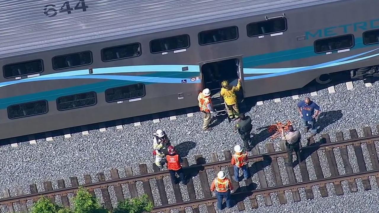 This aerial image shows a stopped Metrolink train after its engine compartment caught fire on Thursday, June 5, 2014.
