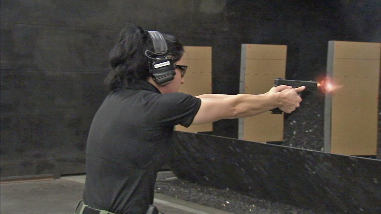 A female Orange County sheriffs deputy fires her weapon during training.