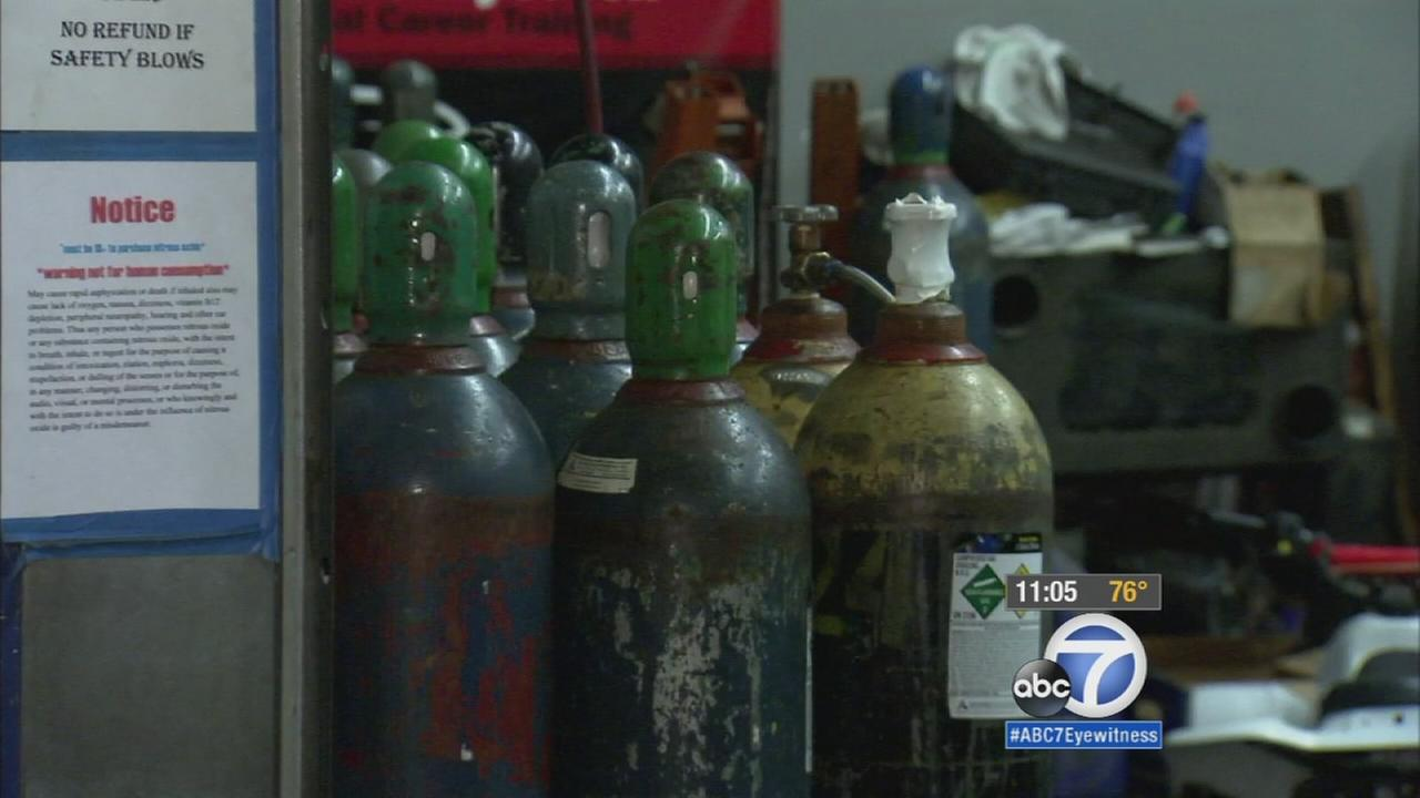 Rialto police officers carried out a raid at an auto repair shop in Fontana, making arrests and seizing dangerous nitrous oxide that was suspected of being sold illegally to minors.