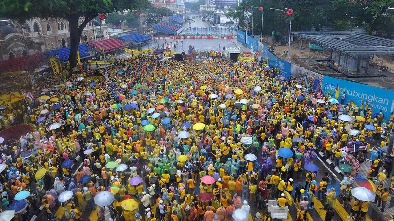 Malaysian protesters gather in the rain during a rally in Kuala Lumpur, Malaysia on Sunday, Aug. 30, 2015.
