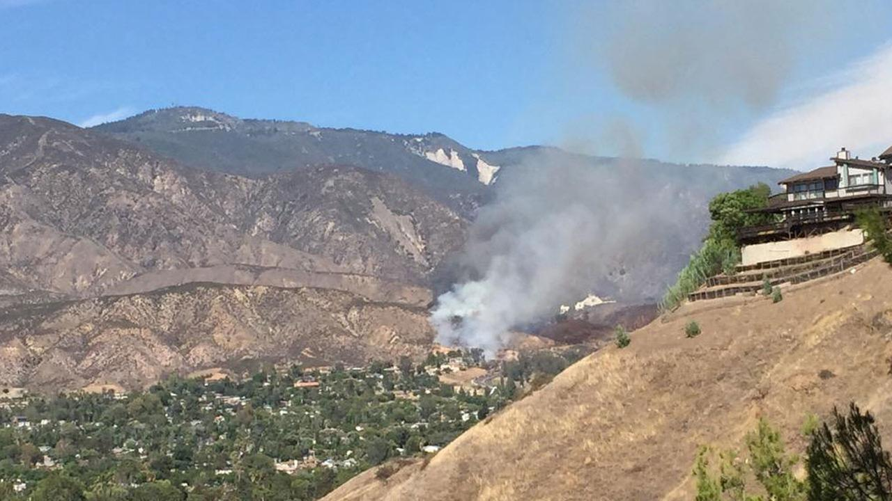 ABC7 viewer Vicky Garza captured a photo of a plume of smoke coming from the brush fire in San Bernardinos Waterman Canyon on Sunday, Aug. 30, 2015.