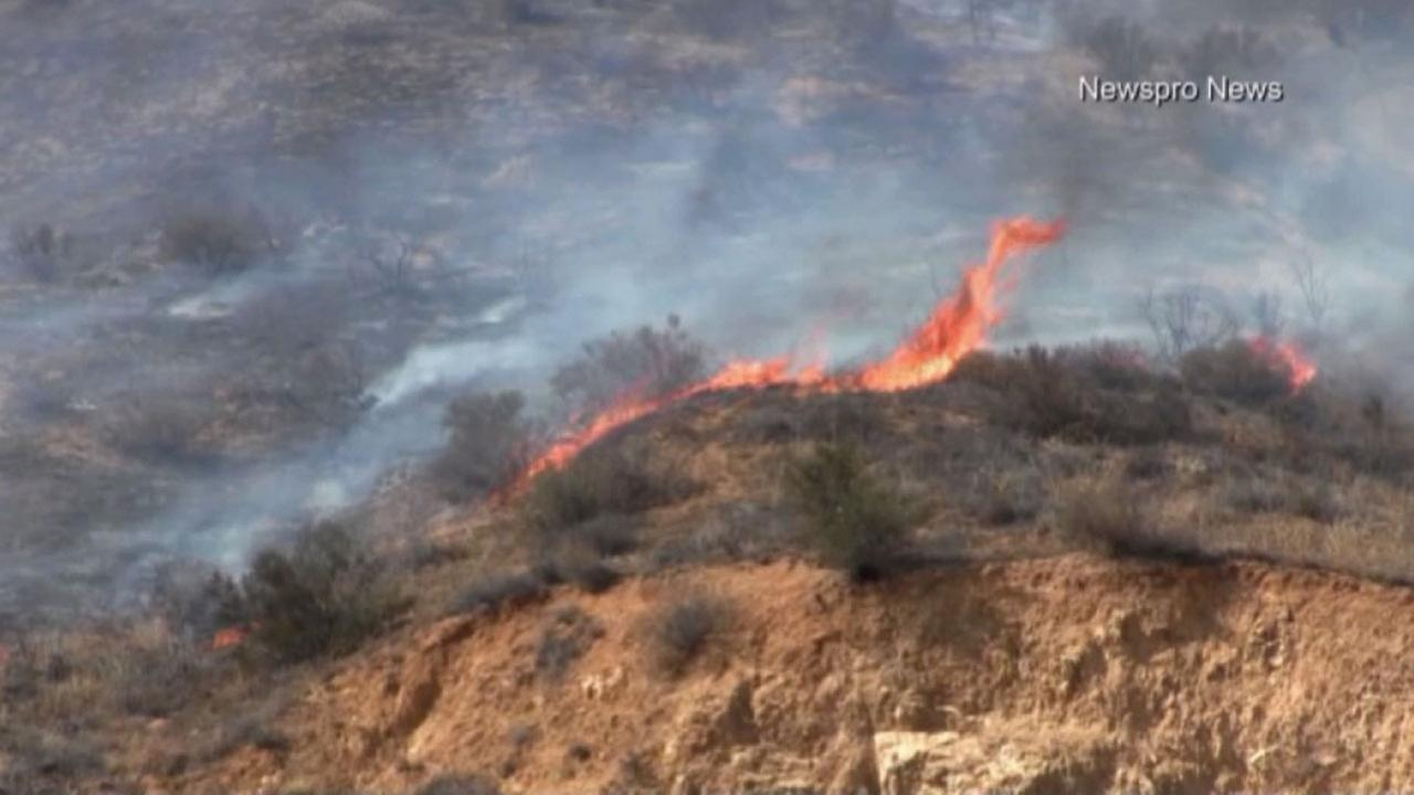 Flames burn through dry brush in San Bernardinos Waterman Canyon on Sunday, Aug. 30, 2015.