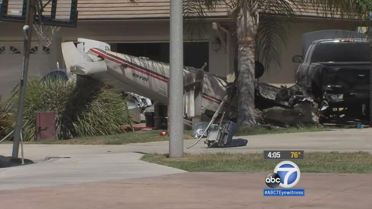 A small plane grazed the roof of a California home and crashed in a driveway Thursday, killing two people onboard, authorities said.