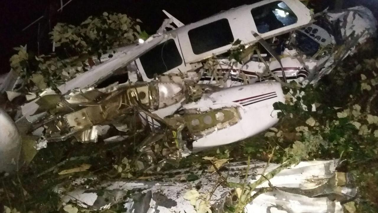 The wreckage of a small plane assigned to the crew of a film starring Tom Cruise that crashed in a rural place of San Pedro de los Milagros, Colombia, is shown on Sept. 11, 2015.
