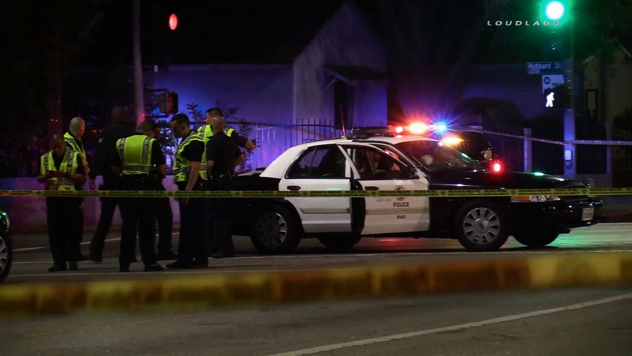 Police investigate the scene of a LAPD officer struck by a civilian vehicle while responding to a robbery call Tuesday, Sept. 15, 2015.