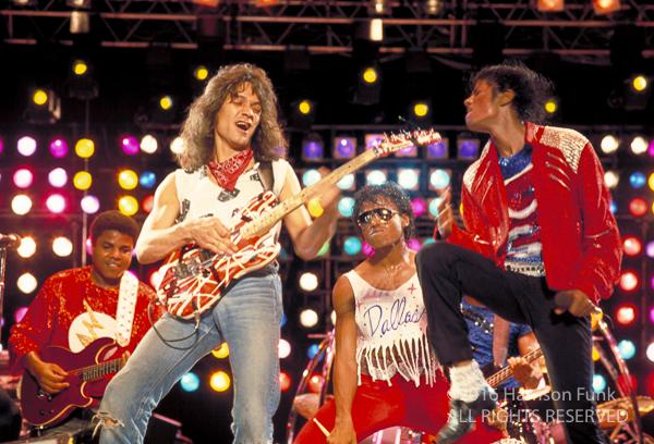<div class='meta'><div class='origin-logo' data-origin='none'></div><span class='caption-text' data-credit='Harrison Funk/ALL RIGHTS RESERVED'>Eddie Van Halen joins Michael Jackson onstage to perform a guitar solo to 'Beat It' during Jackson's Victory Tour show in Dallas.</span></div>