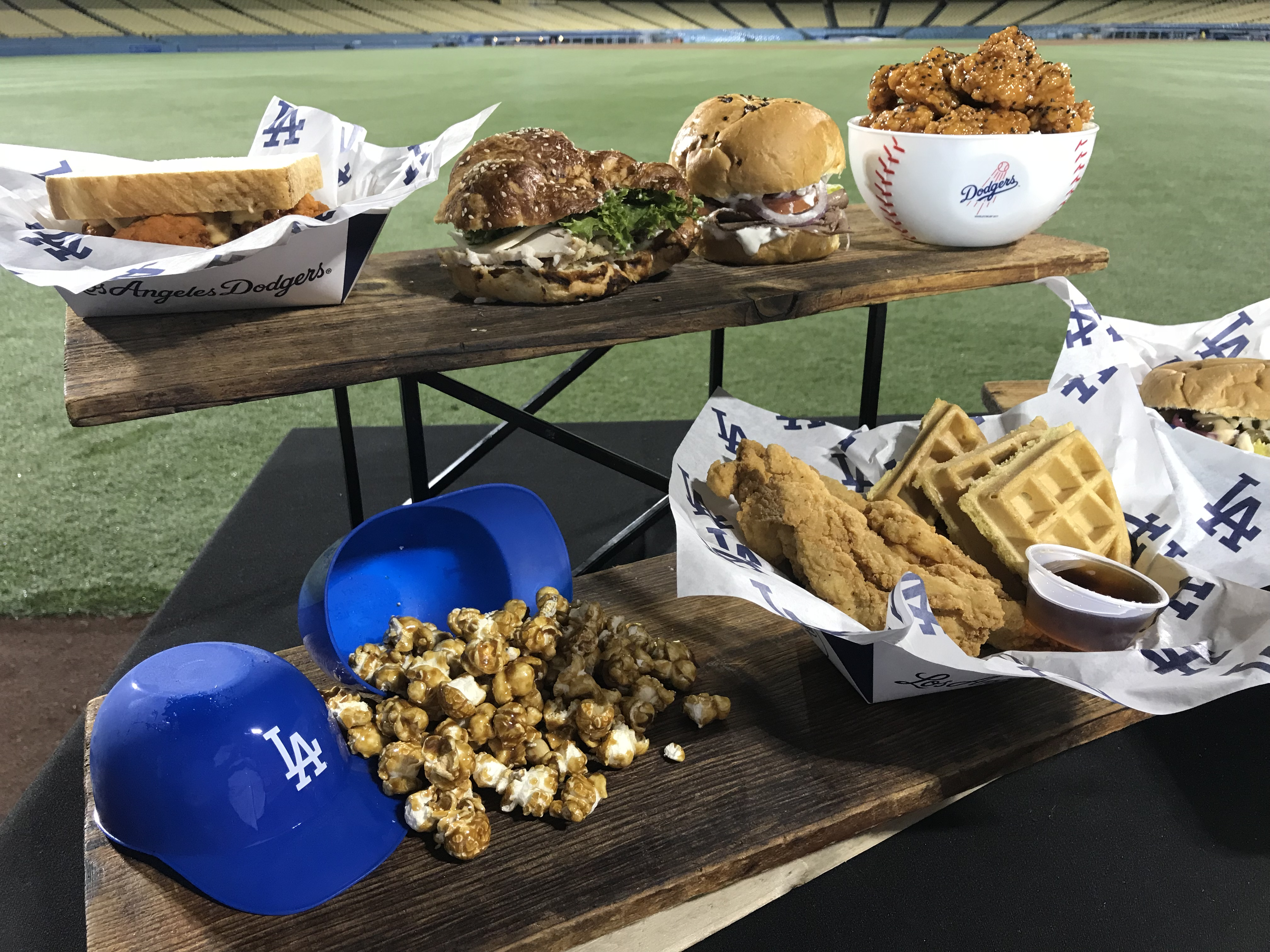 <div class='meta'><div class='origin-logo' data-origin='none'></div><span class='caption-text' data-credit='KABC'>An array of food items ranging from chicken and waffles to popcorn are displayed at Dodger Stadium.</span></div>