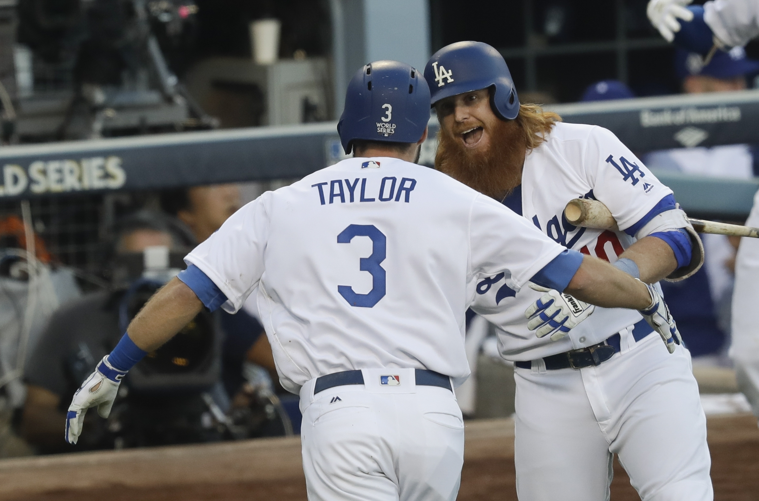 <div class='meta'><div class='origin-logo' data-origin='AP'></div><span class='caption-text' data-credit='(AP Photo/Alex Gallardo)'>Los Angeles Dodgers' Chris Taylor is congratulated by Justin Turner after hitting a home run during the first inning of Game 1 against the Houston Astros Tuesday, Oct. 24, 2017.</span></div>