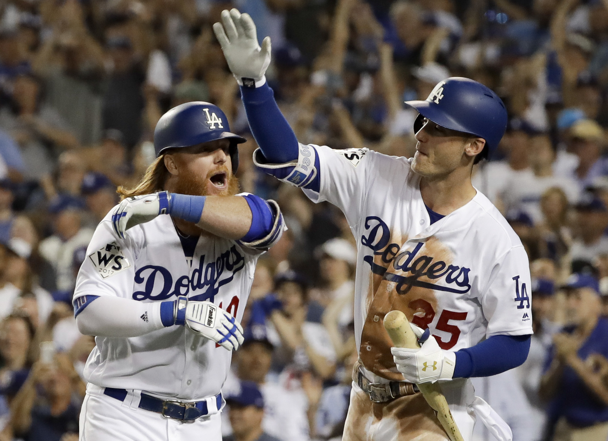 <div class='meta'><div class='origin-logo' data-origin='AP'></div><span class='caption-text' data-credit='(AP Photo/Matt Slocum)'>Los Angeles Dodgers' Justin Turner, left, celebrates his two-run home run with Cody Bellinger against the Houston Astros during the sixth inning of Game 1 in Los Angeles.</span></div>