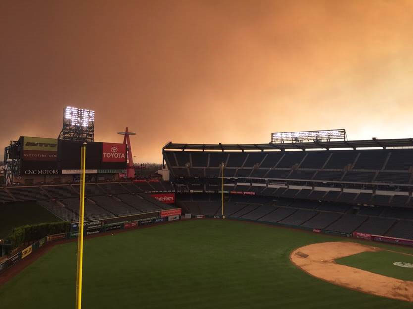 <div class='meta'><div class='origin-logo' data-origin='none'></div><span class='caption-text' data-credit='Via Twitter user @DirtStar0602'>The brush fire ranging in the Anaheim Hills area can even be seen from Angel Stadium</span></div>