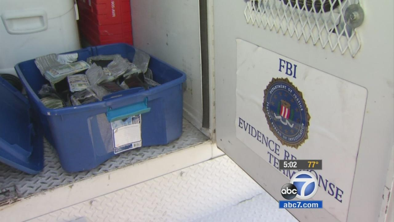A plastic bin full of cash is shown inside of an FBI truck on Wednesday, Oct. 7, 2015.