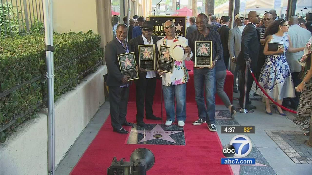 The members of Kool and the Gang stand together over their Hollywood Walk of Fame star on Thursday, Oct. 8, 2015.
