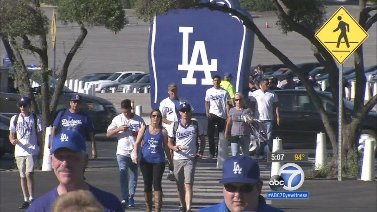 Groups of Los Angeles Dodgers fans head to the stadium for the National League Division playoffs that start Friday, Oct. 9, 2015.