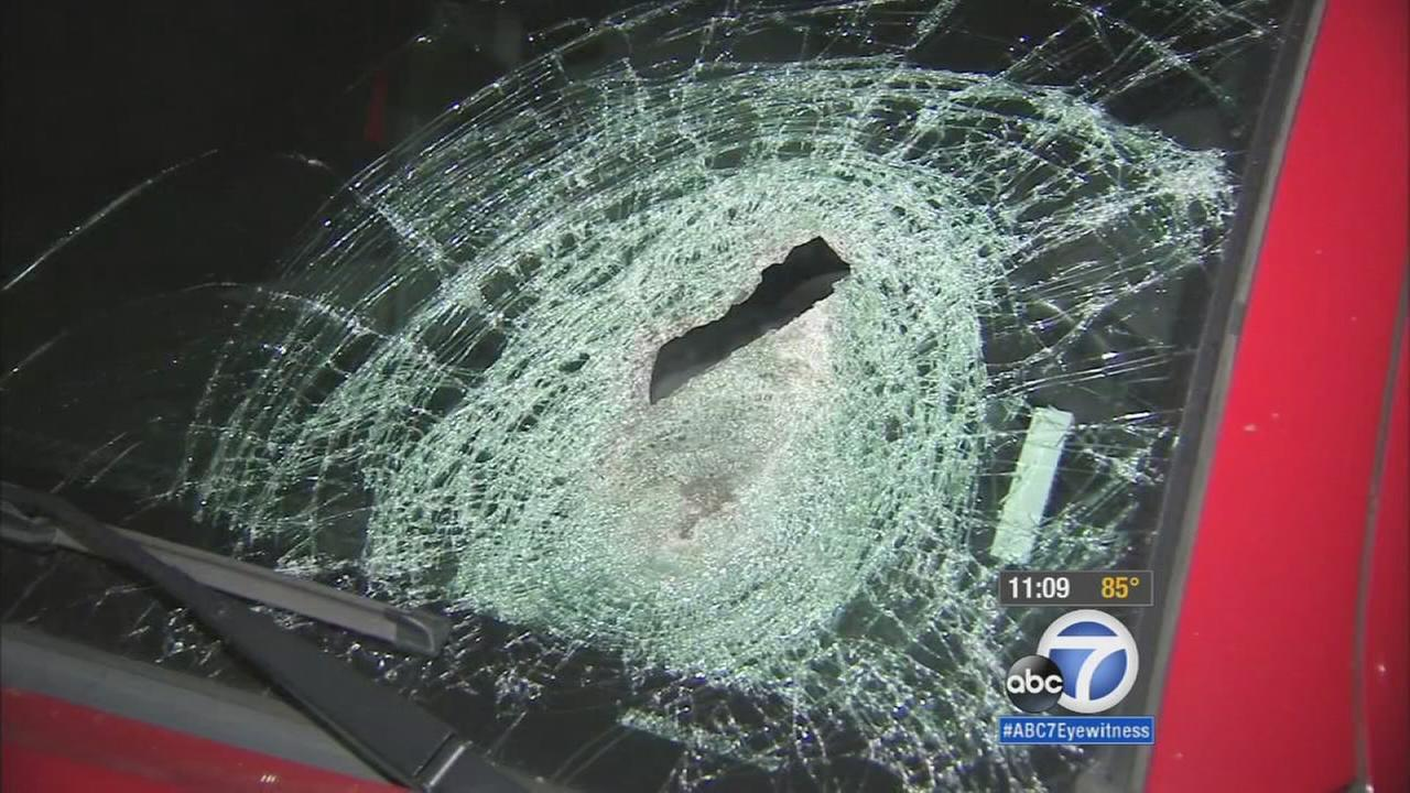 The windshield of a womans truck was shattered after a heavy object smashed into it on Sunday, Oct. 11, 2015.