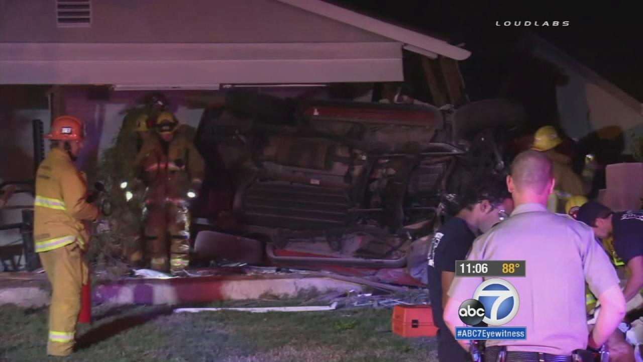 A vehicle slammed into a home in Granada Hills, shearing off a large portion of the residence on Tuesday, Oct. 13, 2015.