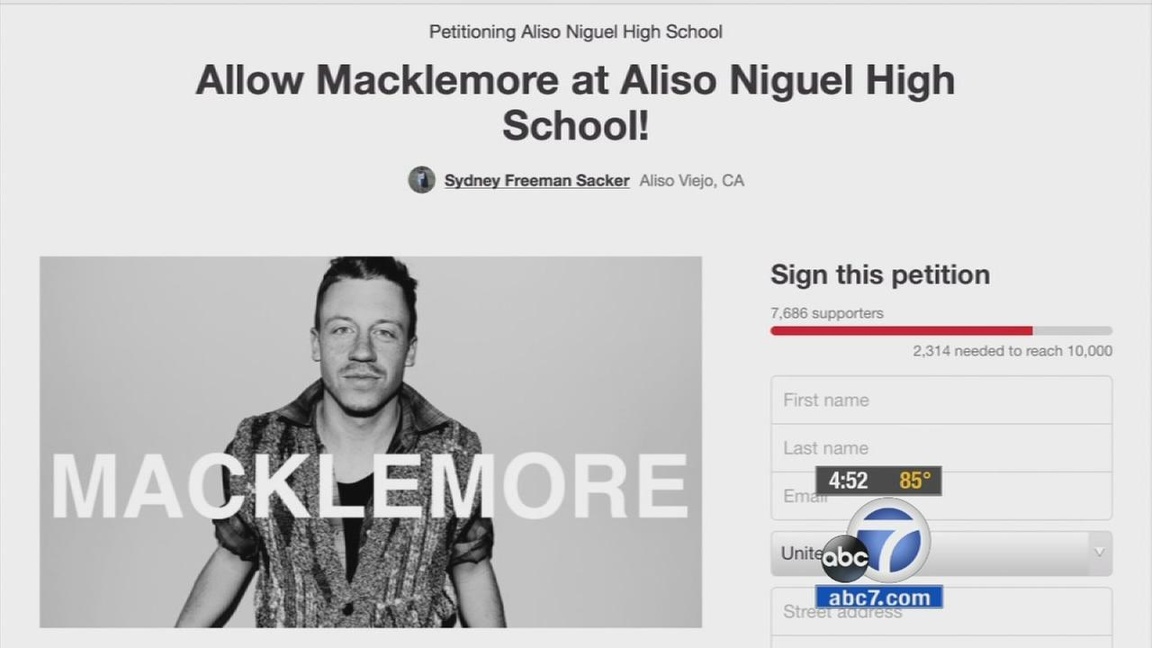 A petition announces the protest of a principals rejection of hip hop artists Macklemore and Ryan Lewis at Aliso Niguel High School.