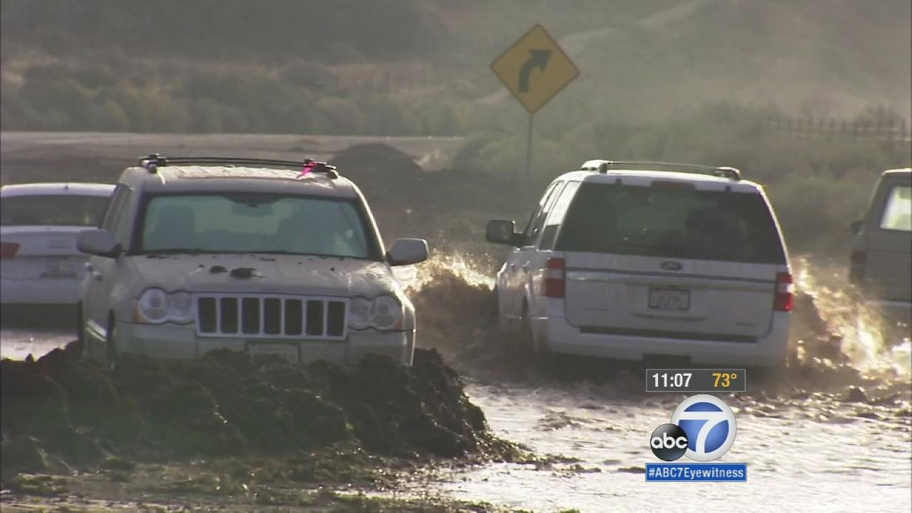 Leona Valley residents are cleaning up a huge muddy mess left behind by flash flooding triggered by rain on Thursday, Oct. 15, 2015.