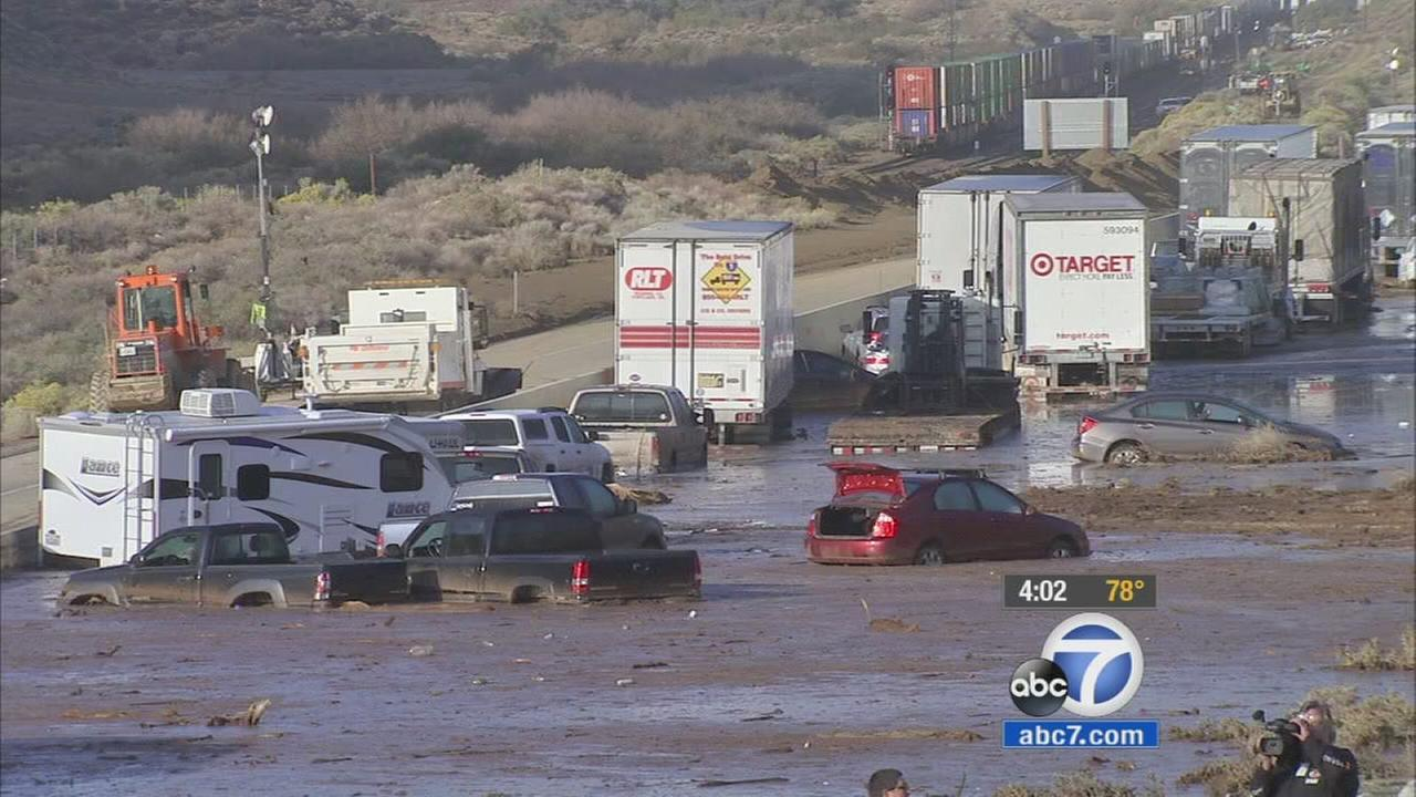 Cars, trucks and big rigs are stuck in inches of mud in Tehachapi on Saturday, Oct. 17, 2015.