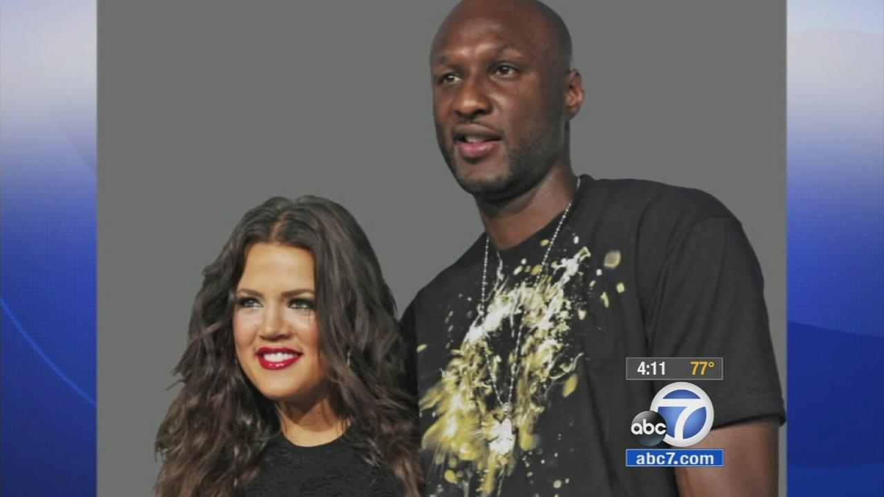 Khloe Kardashian and Lamar Odom pose for a picture.