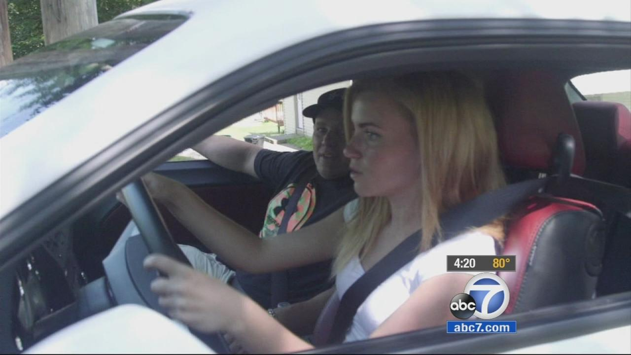 A teenage driver is shown behind the wheel of a car in an undated file photo.
