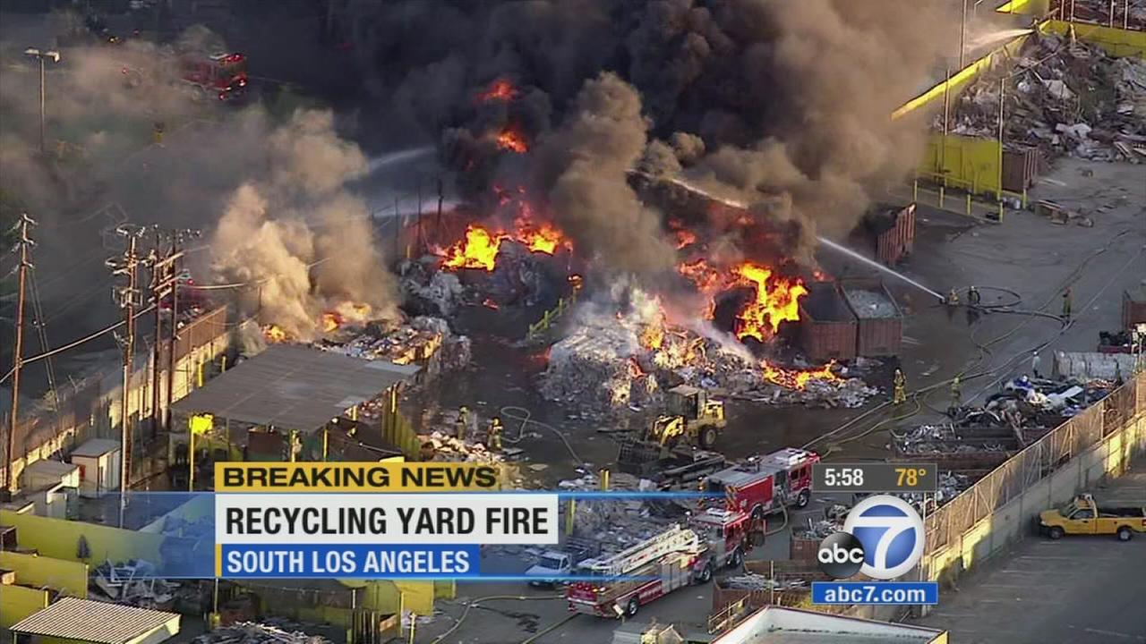 The Los Angeles Fire Department battles a large fire at a South Los Angeles recycling center on Thursday, Oct. 29, 2015.