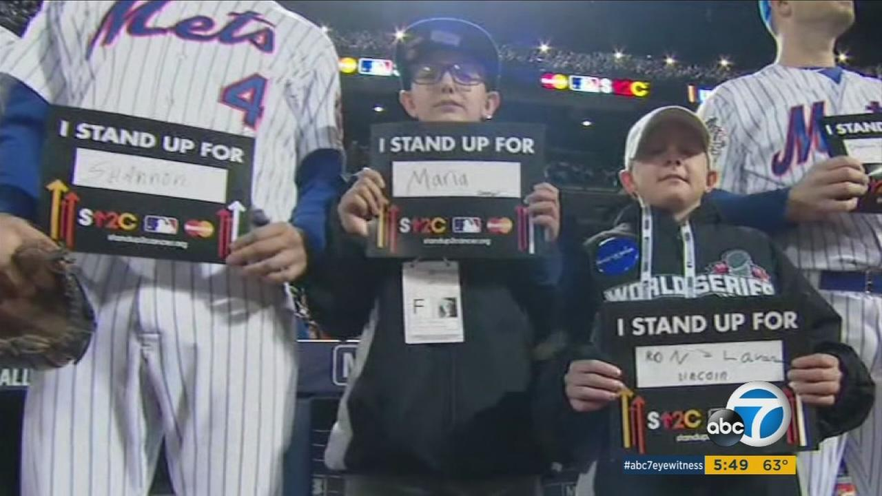 Connor Coughenour stands up to cancer during the 2015 World Series in New York City on Friday, Oct. 30, 2015.