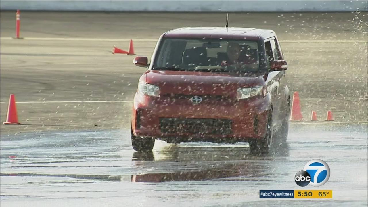 A professional driver shows what it is like to drive in slick, wet conditions on a road in a demonstration at the Irwindale Speedway on Thursday, Nov. 5, 2015.