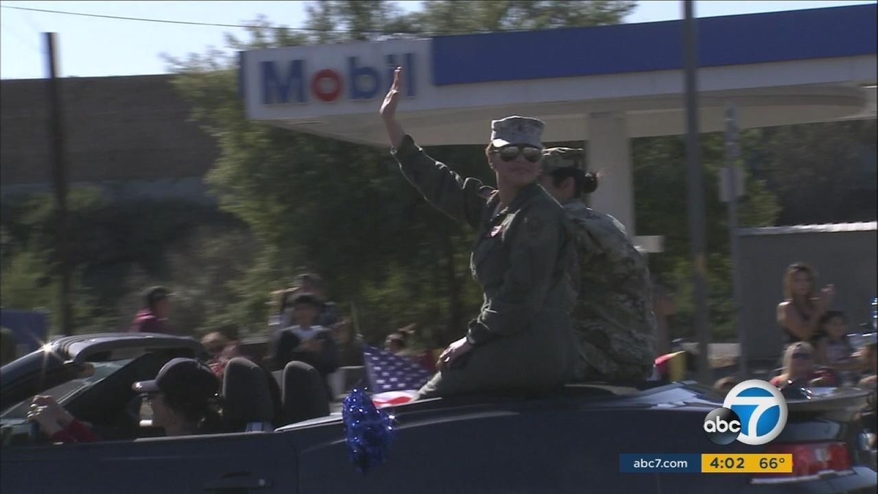 Veterans wave at crowds during the 2015 San Fernando Valley Veterans Day Parade Wednesday, Nov. 11, 2015.