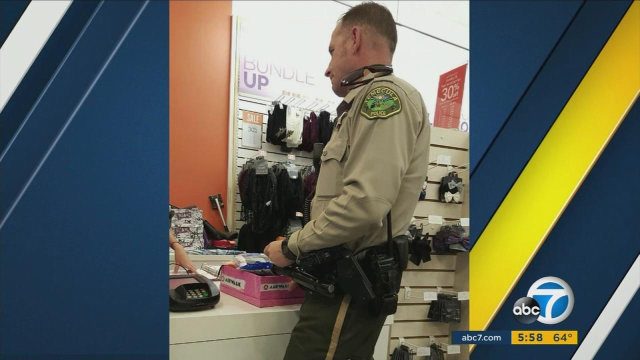 Photo of Temecula Officer Bruce Pierson buying shoes for a homeless woman has gone viral.