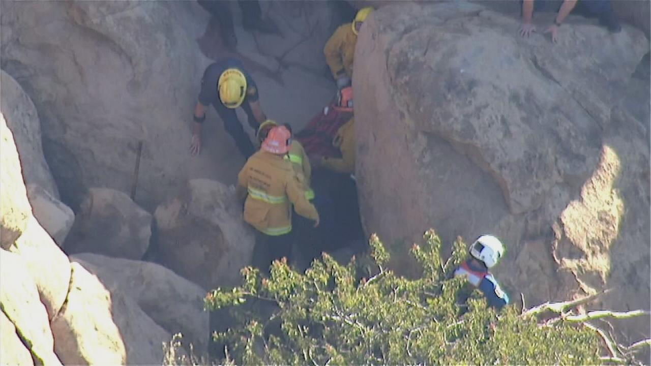 Crews with the Los Angeles Fire Department rescue a 23-year-old man who fell 20 feet at Stoney Park on Saturday, Nov. 14, 2015.