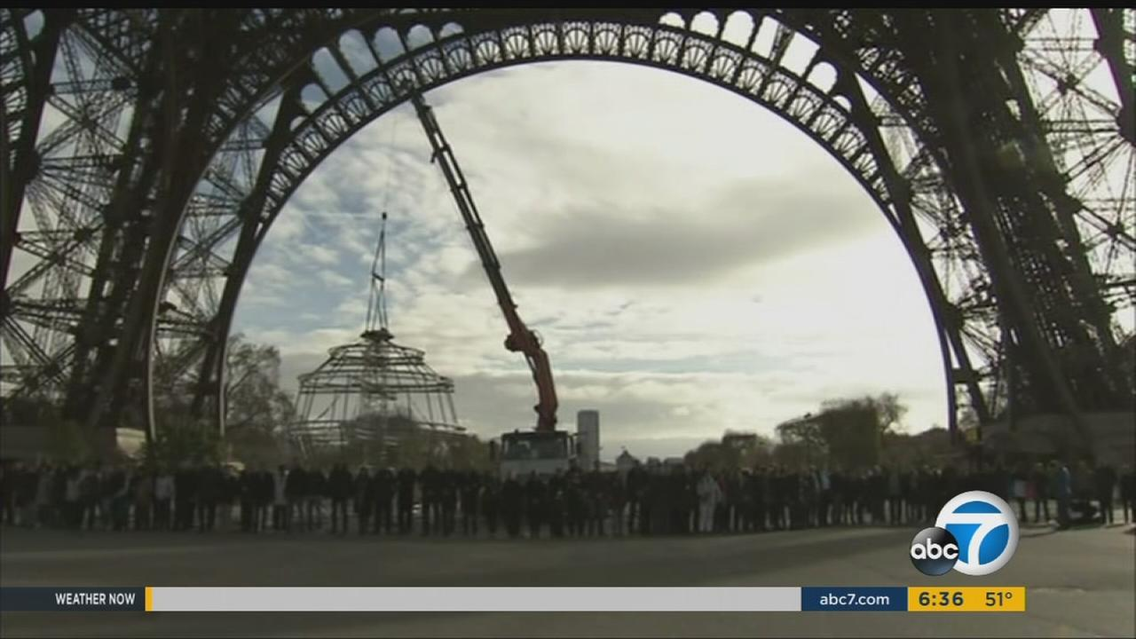 Hundreds gathered at the iconic Eiffel Tower and held a moment of silence to honor the victims of the terror attacks in Paris on Monday, Nov. 16, 2015.