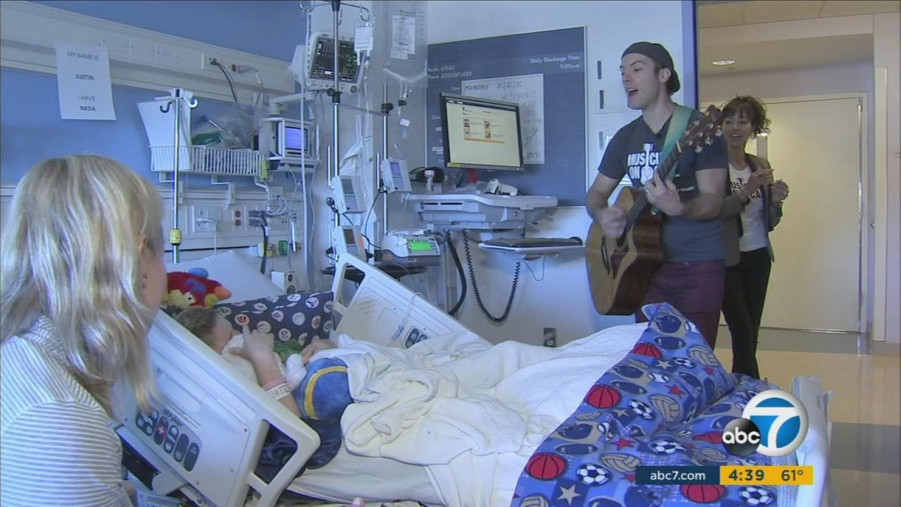 Musicians on Call group perform songs for a child at UCLAs Mattel Childrens Hospital on Monday, Nov. 16, 2015.