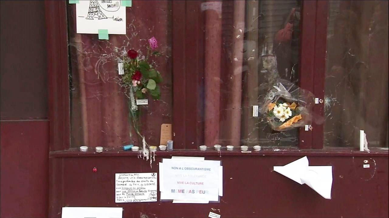 Flowers were placed inside bullet  holes in the windows of restaurants that were hit by terrorist gunfire in Paris on Friday, Nov. 13, 2015.