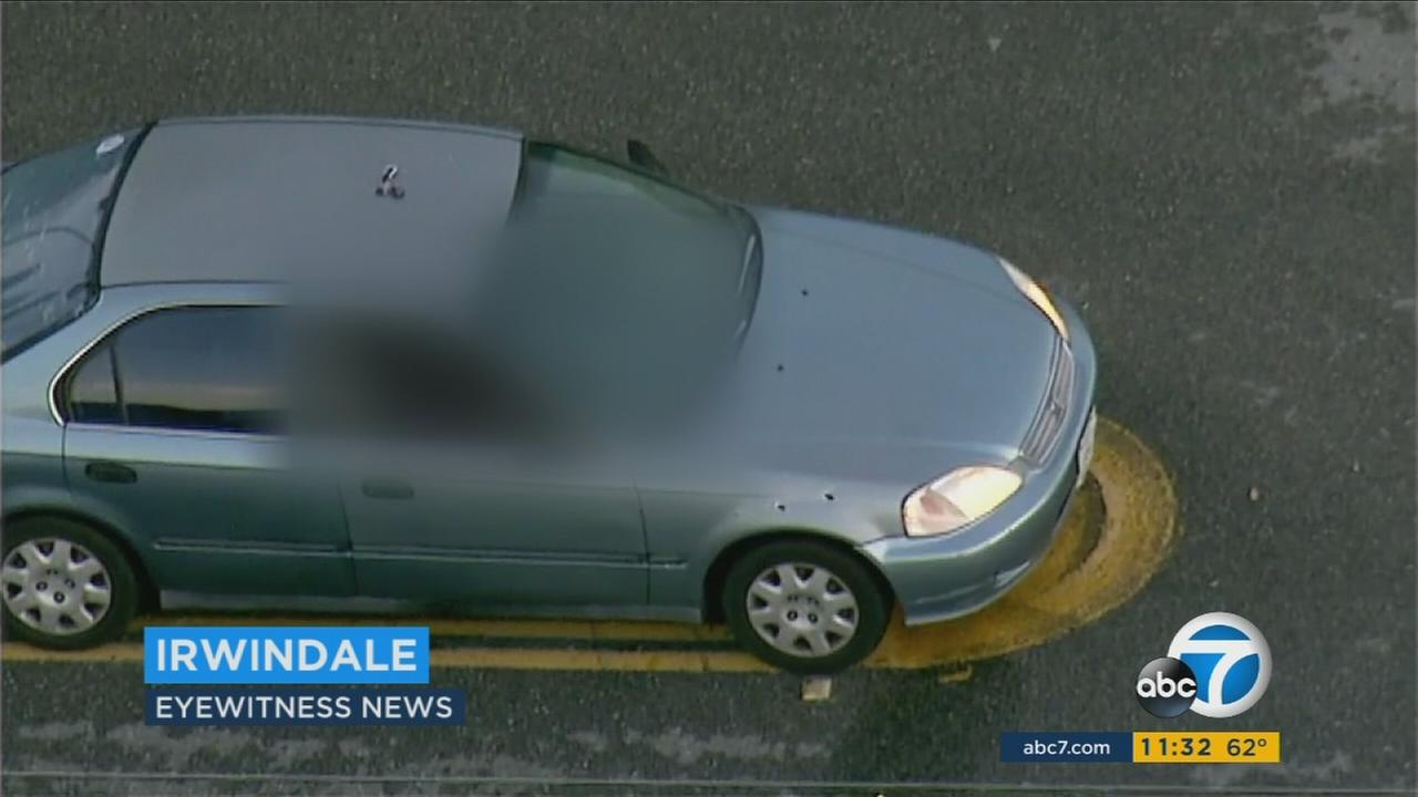 A bullet-riddled car where a man was found shot to death in Irwindale early Monday, Nov. 25, 2015.