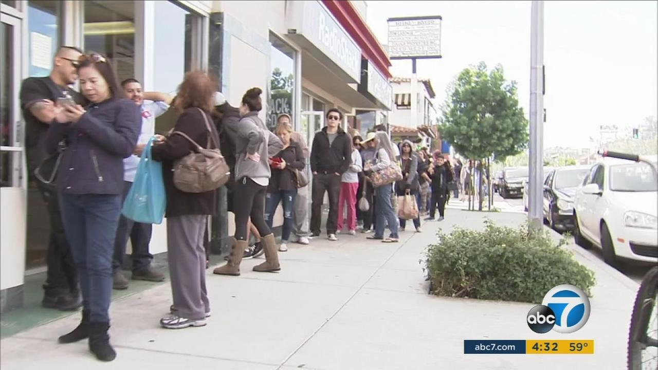 Last-minute shoppers swarm grocery stores the day before Thanksgiving.