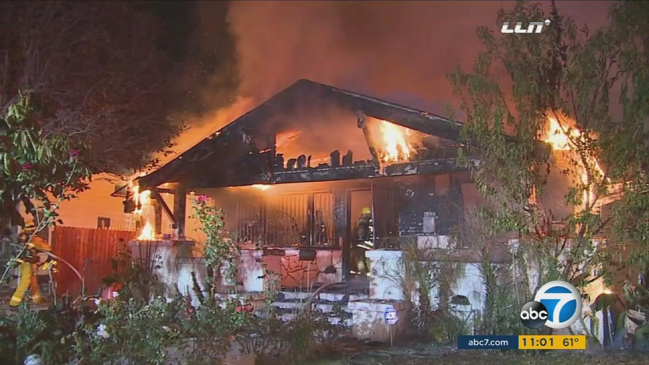 A fire that may have been intentionally set ripped through a South Los Angeles home on Thursday, Nov. 26, 2015.