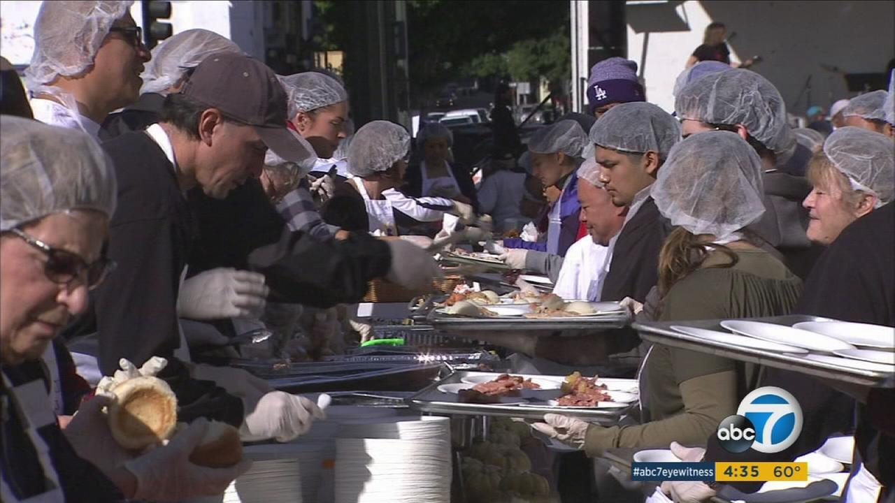 One ton of turkey is served during Fred Jordan Missions annual Thanksgiving banquet on Skid Row in Downtown Los Angeles on Thursday, Nov. 26, 2015.
