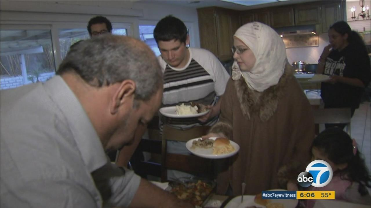Two families who fled Syria are celebrating their first Thanksgiving in Southern California.