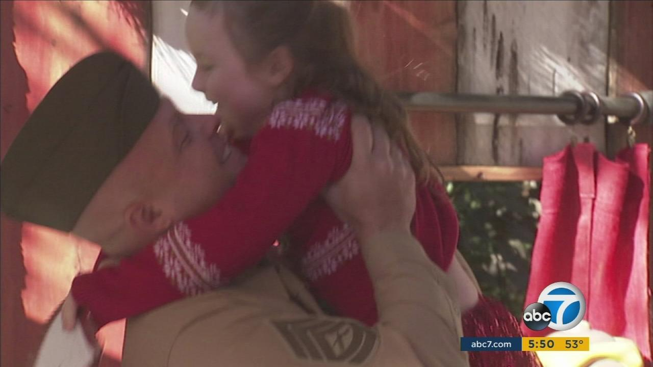 U.S. Marine Brian Demo surprised his  5-year-old daughter Abigail at Disneyland for Christmas on Monday, Dec. 14, 2015.
