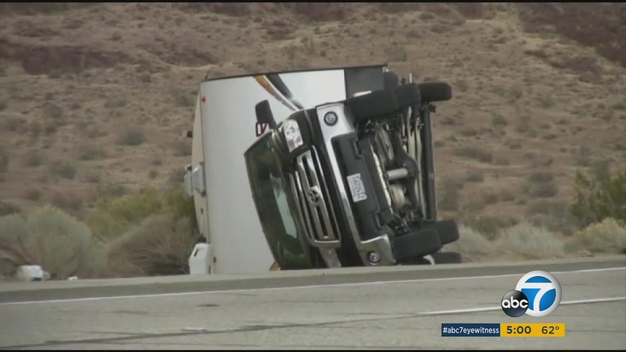 Several big trucks were blown over along the 14 Freeway in the Mojave Desert due to high winds on Tuesday, Dec. 22, 2015.