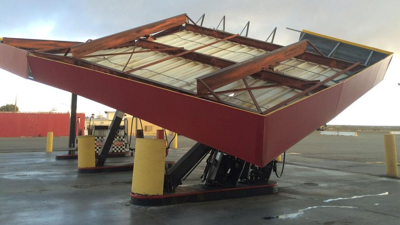 A gas station awning came crashing down due to fierce winds in the Mojave Desert on Wednesday, Dec. 23, 2015.