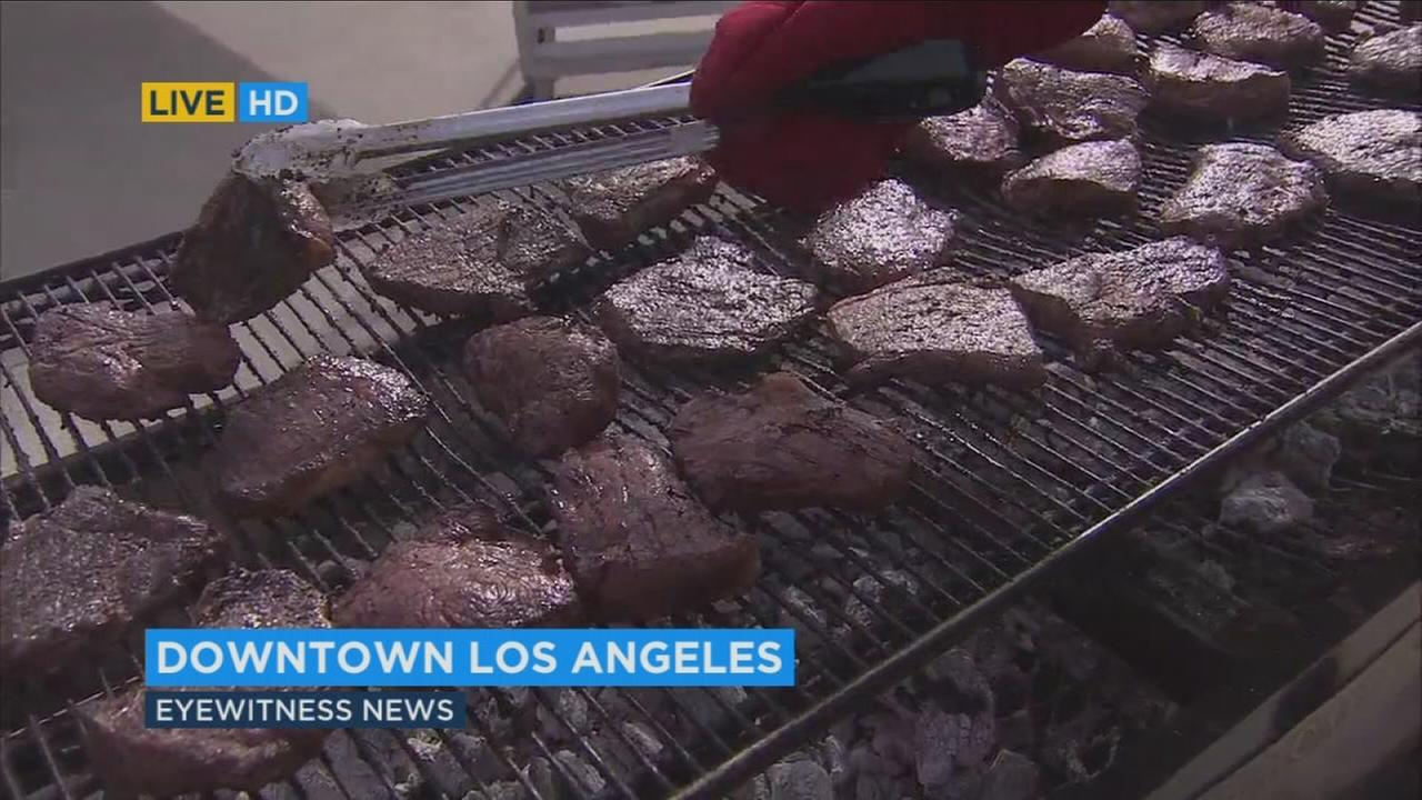 Hundreds of steaks were grilled up for a special holiday dinner for the homeless in downtown Los Angeles on Thursday, Dec. 24, 2015.