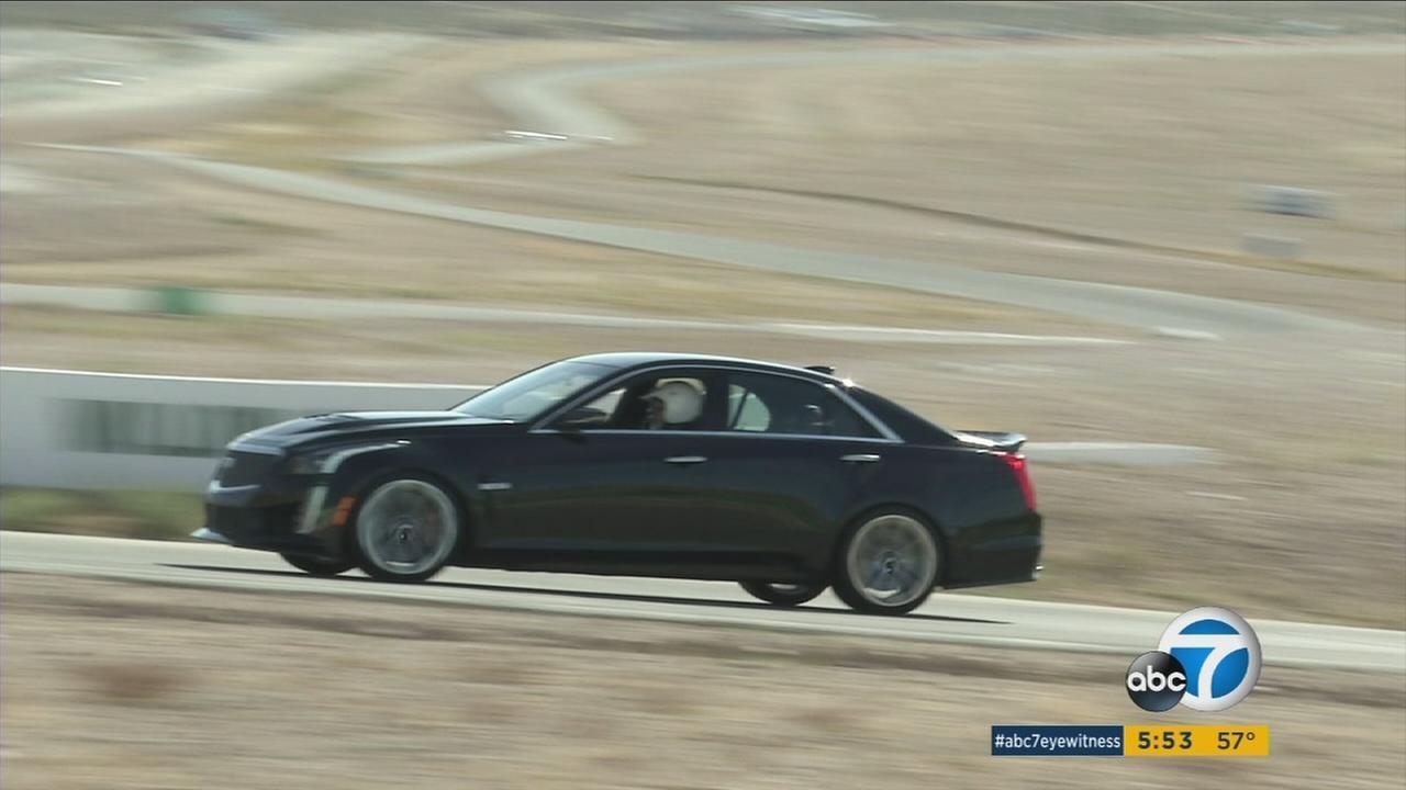 A 2016 Cadillac CTS-V sedan speeding on a racetrack.
