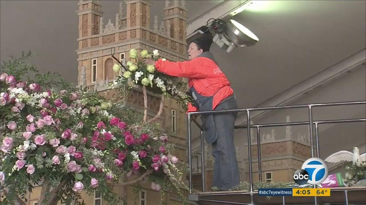 Volunteers put last-minute touches on Rose Parade floats on Thursday, Dec. 31, 2015.