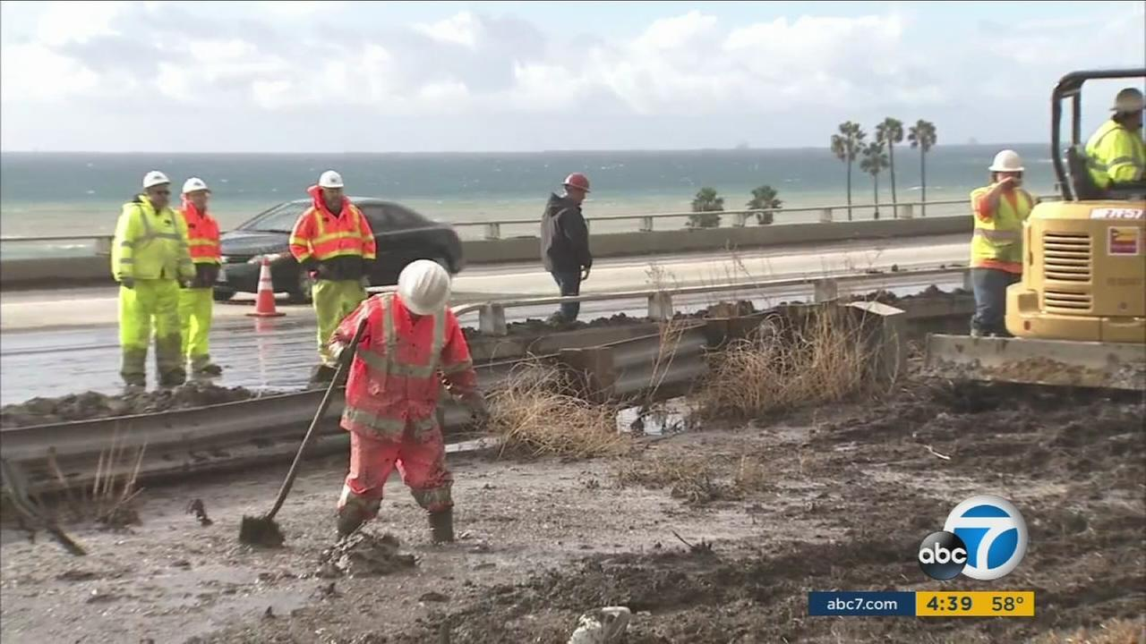 Caltrans crews work to clear mud from the 101 Freeway in Solimar Beach on Tuesday, Jan. 5, 2016.