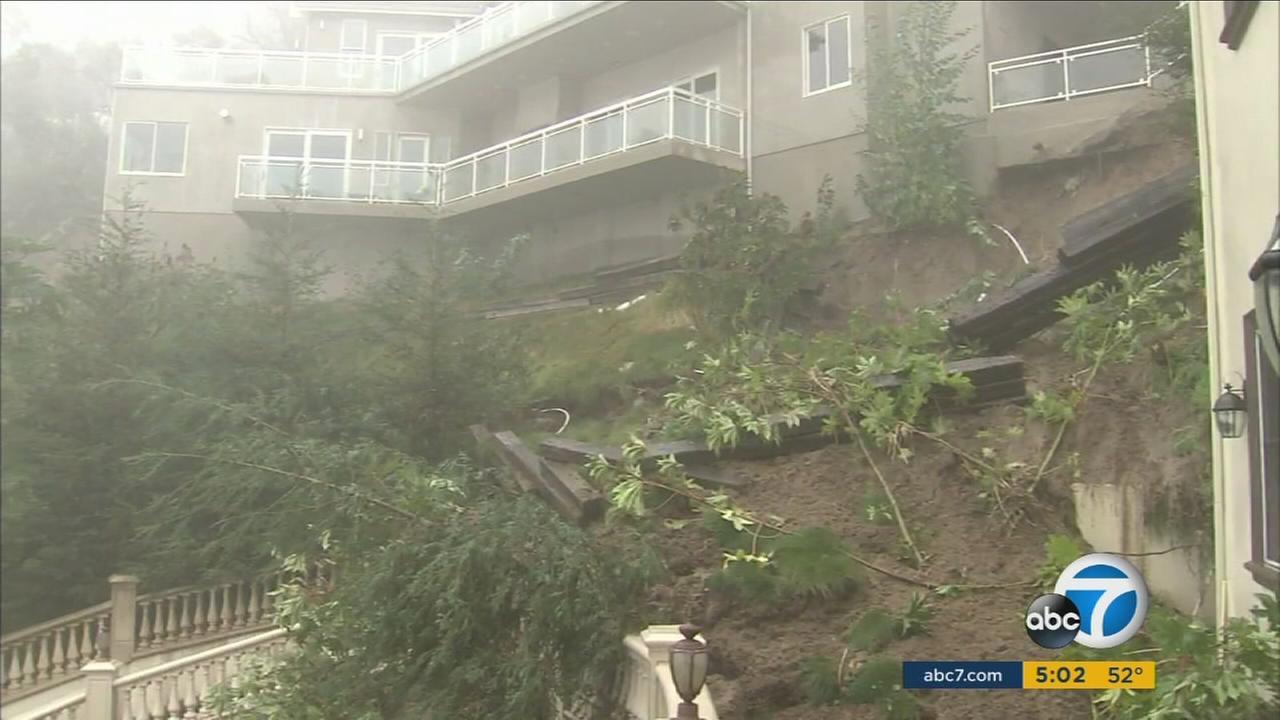 The ground underneath a Pasadena home slides down a hillside on Wednesday, Jan. 6, 2016.