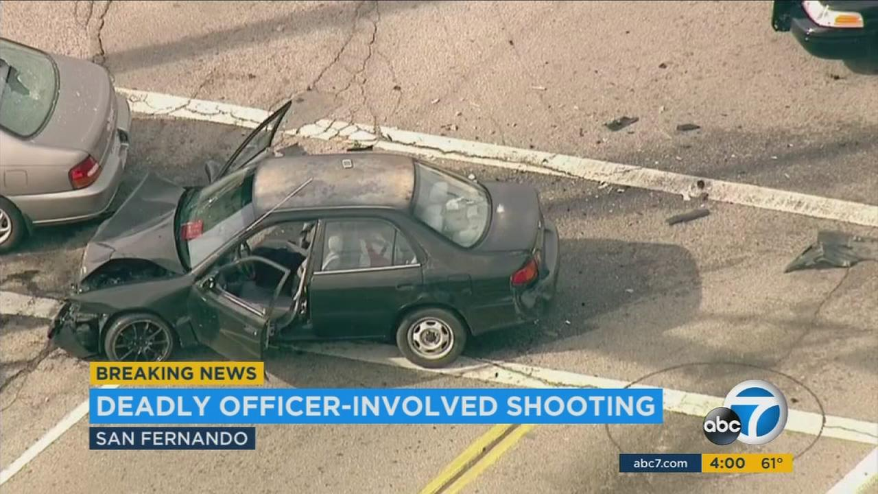 A suspect was shot and killed by police after a short chase near the intersection of San Fernando Road and Hubbard Street in San Fernando on Monday, Jan. 11, 2016.