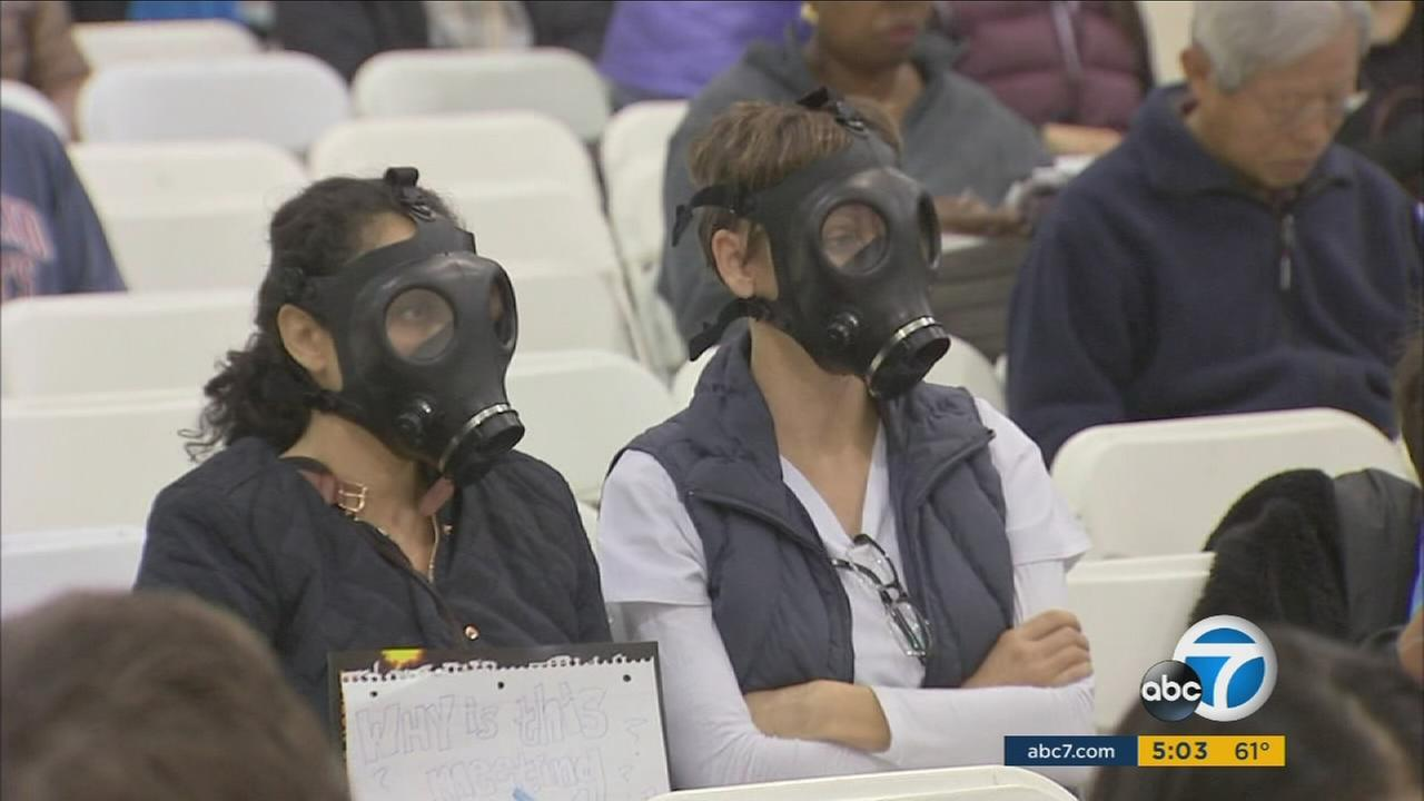 Residents attending a meeting at a Granada Hills school wore gas masks in protest of the Porter Ranch gas leak on Saturday, Jan. 16, 2016.