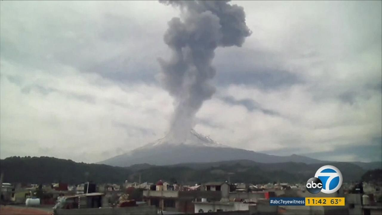 The Popocatepetl volcano seen spewing a large plume of ash and gas on Tuesday, Jan. 19, 2016, in the states of Puebla, Mexico.